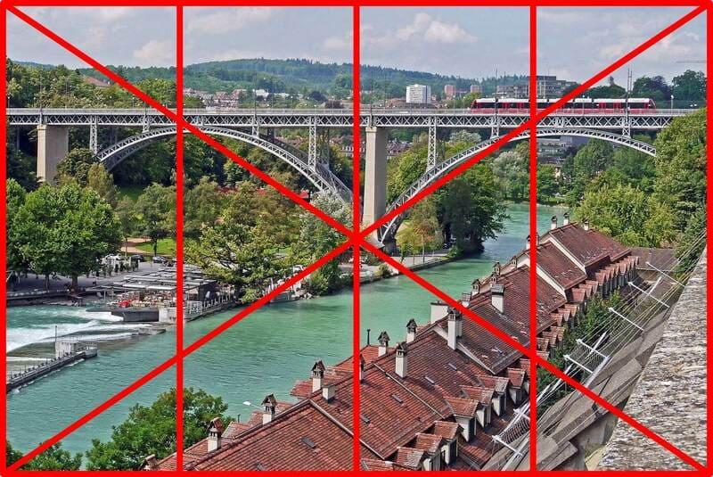 レイルマン構図で撮られた橋の上の列車の写真